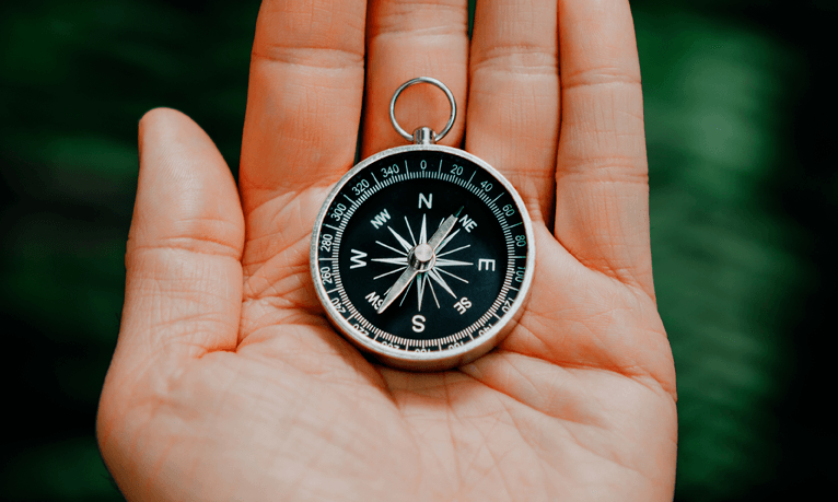compass in a persons hand